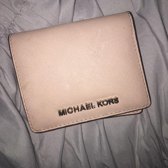 6be9f3de613e Light pink Michael Kors small wallet. M_5afc5066daa8f6f104070cf9